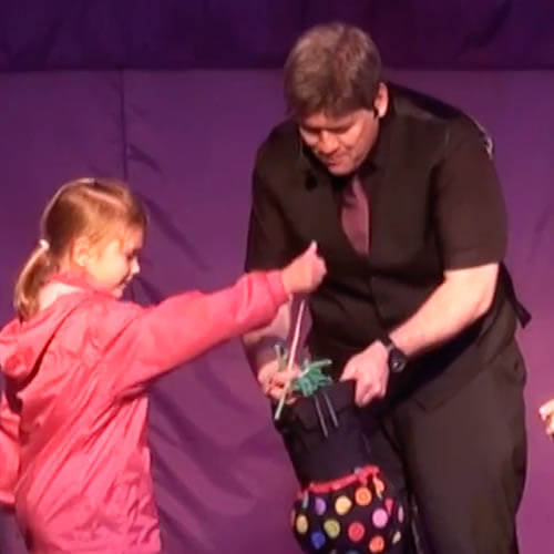 Kimmo children's entertainer doing a trick