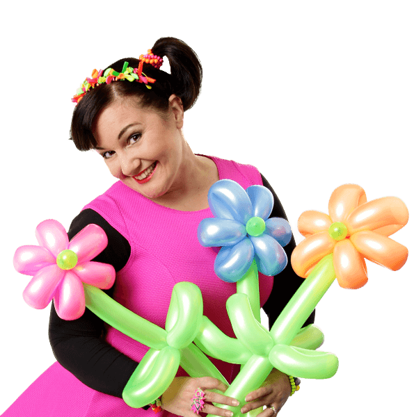 Female kids party entertainer holding balloons