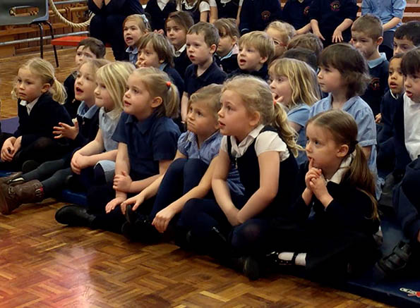 schoolchildren watching a children's entertainer in Chesterfield