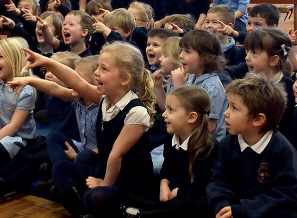 An audience watching Kimmo at a school in Matlock, Derbyshire